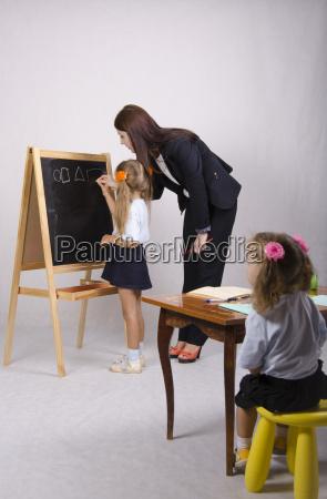 at blackboard girl with tutor draw