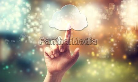 cloud computing symbol being pressed by