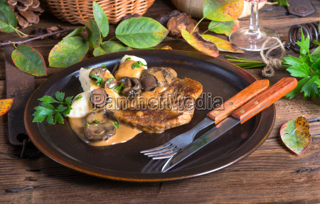 steak with potato dumplings and forest