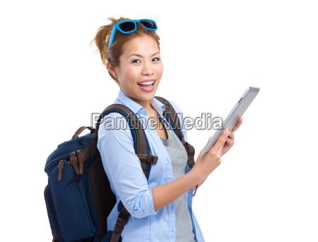 woman traveler use tablet