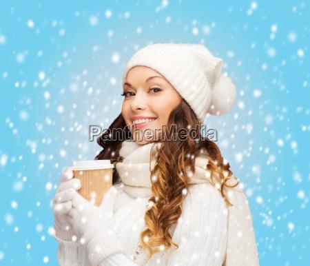woman in hat with takeaway tea