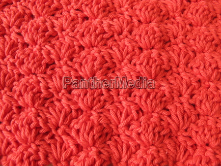 background of crocheted shell pattern in