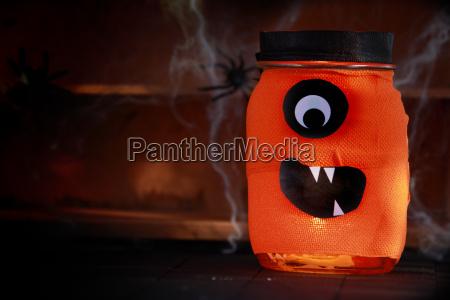 orange jar decorated as a halloween