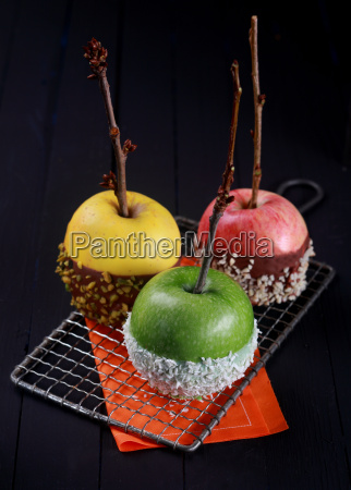 three candy coated apples for halloween