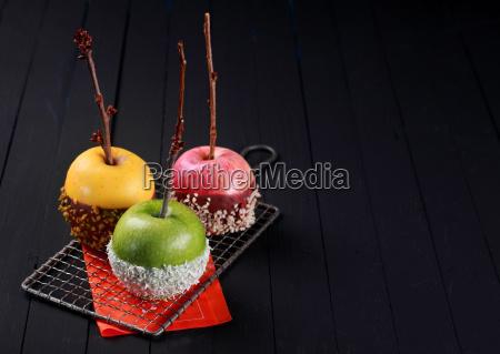 trio of colorful halloween apple desserts