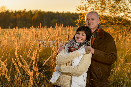 romantic couple hugging in countryside autumn