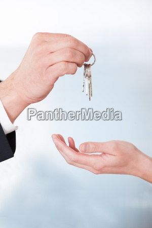 consultant giving keys to woman