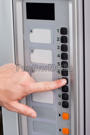 close up of hand pressing button