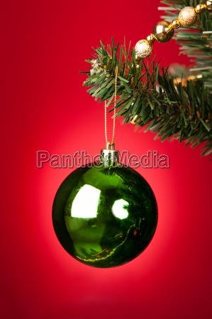 green bauble on christmas tree