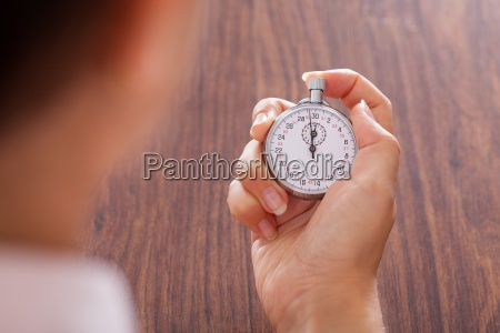 stopwatch in female hand