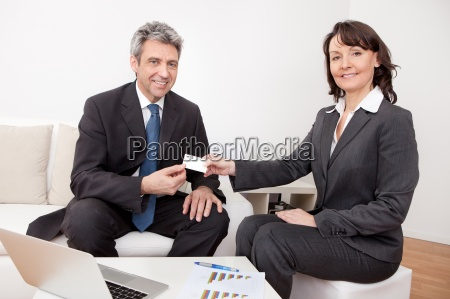 two business people exchanging visiting card