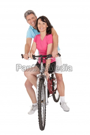 mature active couple doing sports