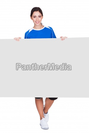 sporty woman holding blank placard