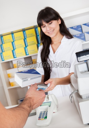 buying medicine at pharmacy