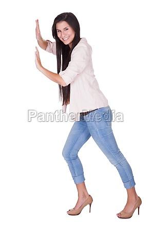 stylish woman posing in a pushing