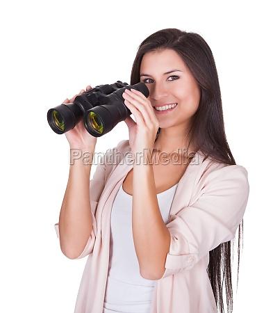 attractive woman with binoculars