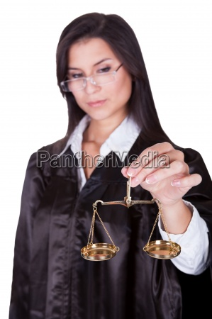 judge holding the scales of justice
