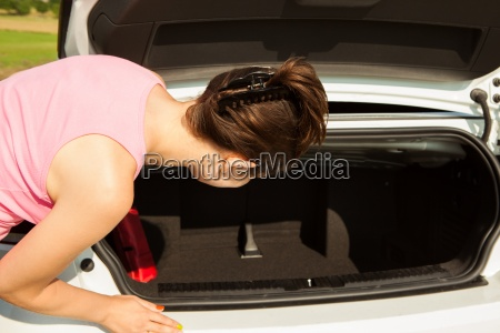 woman looking in car