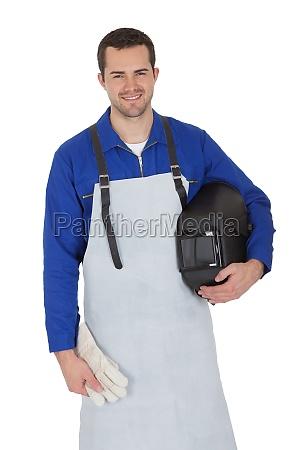 portrait of confident young welder