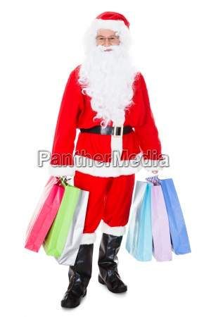 portrait of santa holding shopping bag