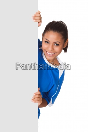 happy young girl holding volleyball and