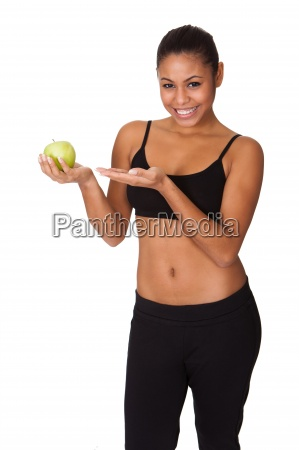 happy woman holding green apple in