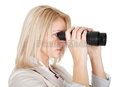 businesswomen looking through binoculars