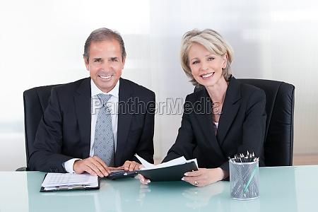 mature businessman and businesswoman planning