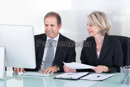 mature businessman and businesswoman at work