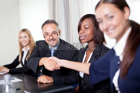 portrait of business colleagues shaking hands