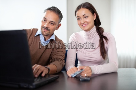 beautiful woman sitting with a man
