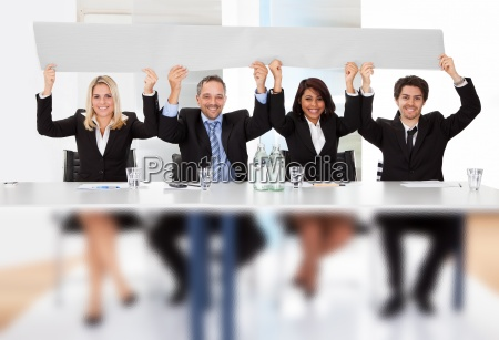 business people holding empty placard