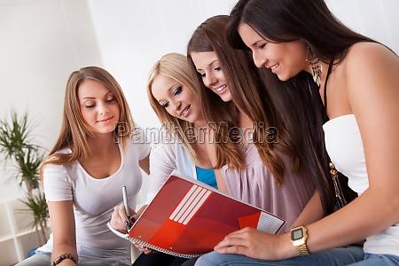 four female students doing homework