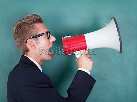 male professor shouting though megaphone