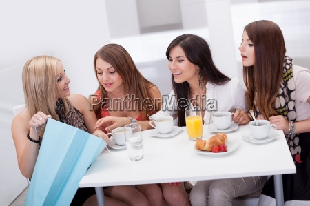 women, friends, looking, at, shopping - 12404486