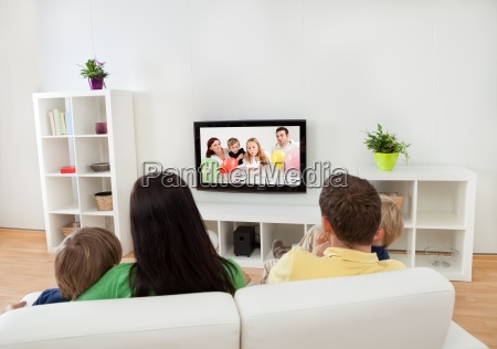 young family watching tv