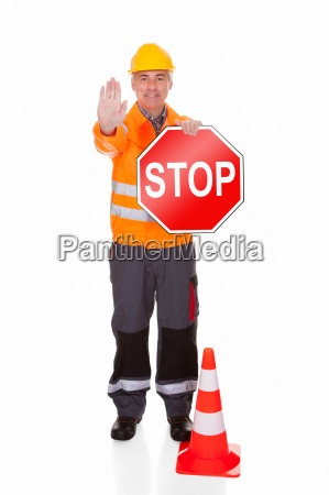 man showing stop sign