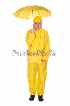 mature man wearing raincoat and holding