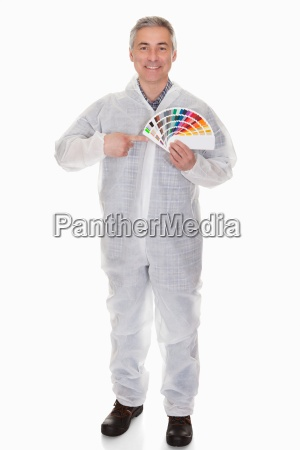 mature man with protective workwear holding