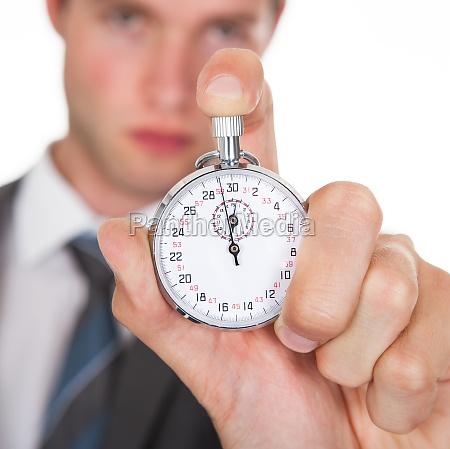 businessman holding stopwatch