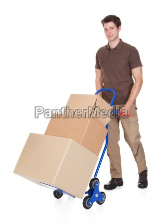 delivery man with hand truck and