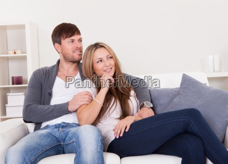 cheerful young couple dreaming about the