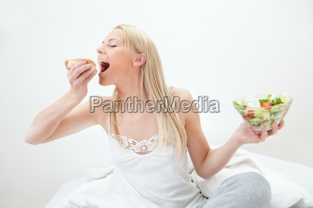 tempted young woman making a food