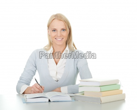 beautiful student girl doing homework