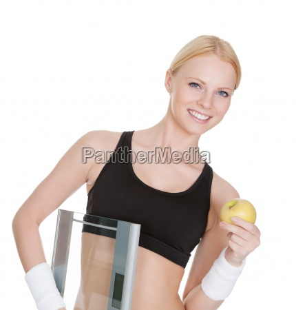 fitness woman with weights and apple