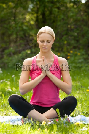 young blonde woman practicing yoga in