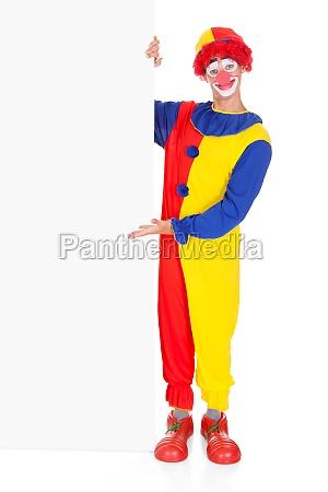 joker presenting blank placard