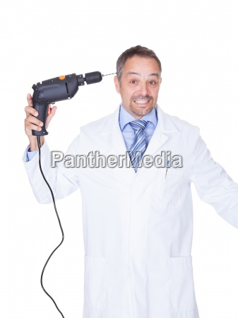 doctor holding drill machine