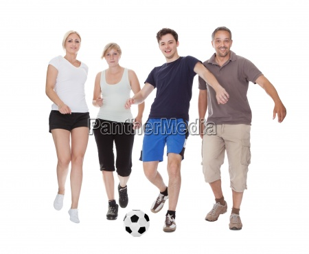 active family playing soccer