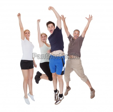 happy excited family jumping